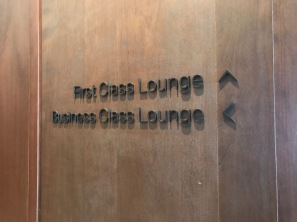 Signs showing the first and business class lounges